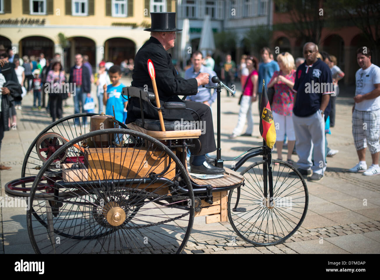 A replica of a Benz Patent-Motorwagen is presented during the eMotionen show on the market square on May 5, 2013 - Stock Image