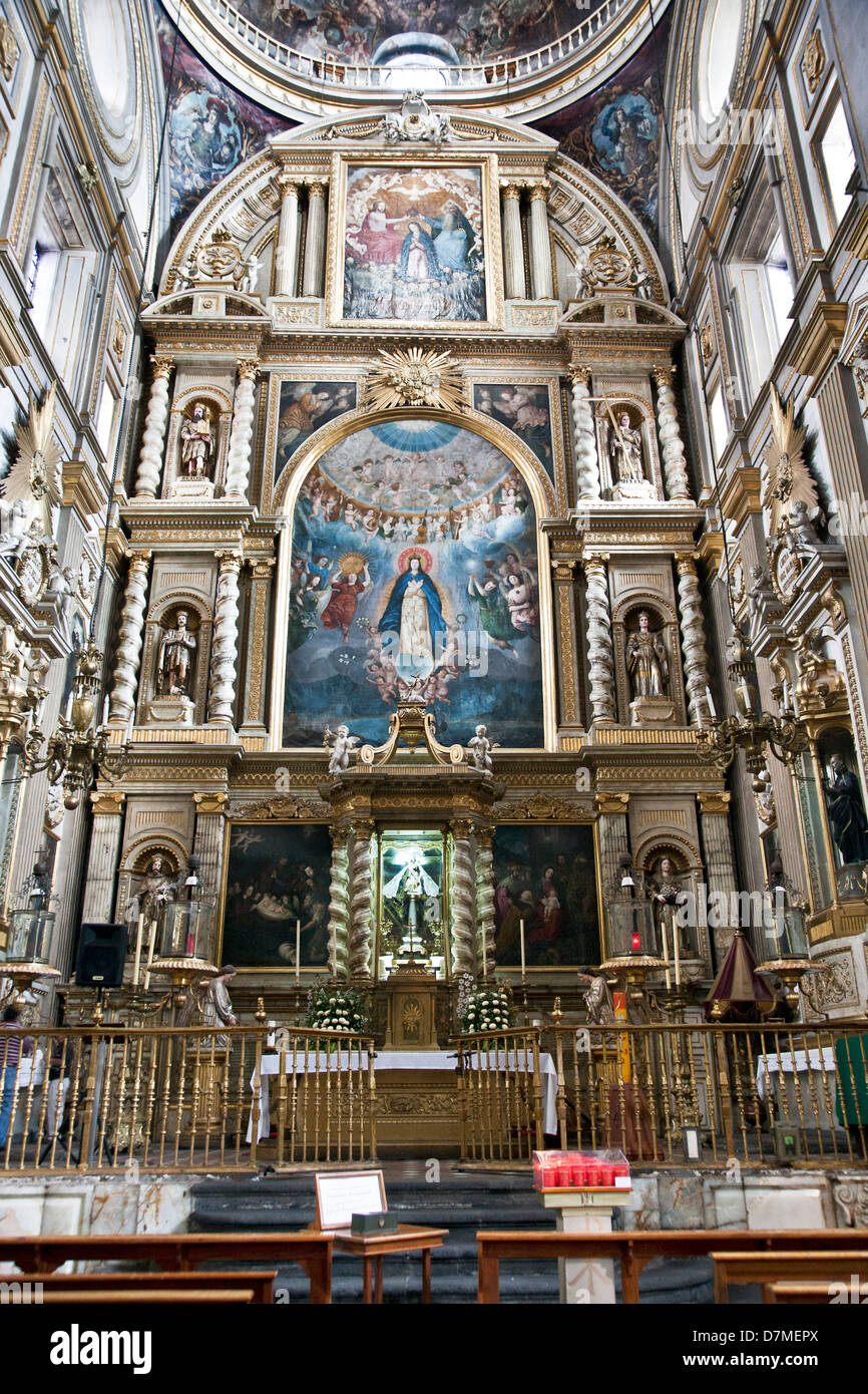 ornate Baroque style gilded Blessed Sacrament Chapel with painting of Virgin Mary at center in rear wall Puebla - Stock Image