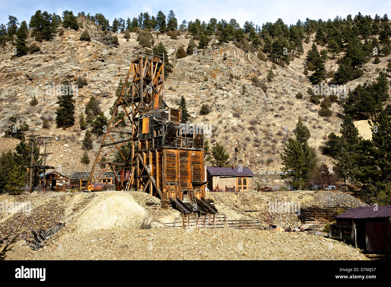 Rustic old gold mine in the Rocky Mountains clings to a ...