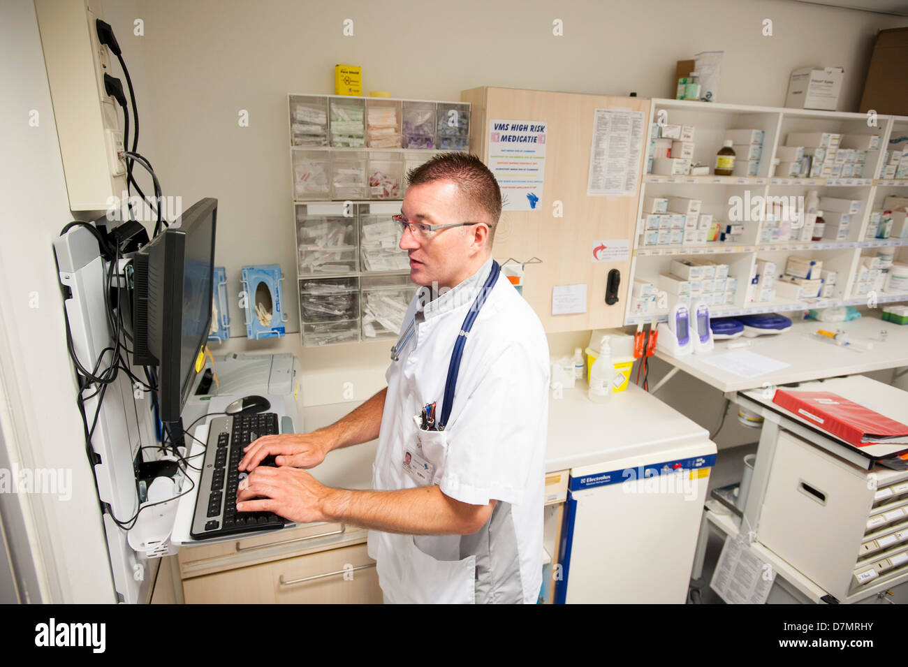 Nurse accessing drug records - Stock Image