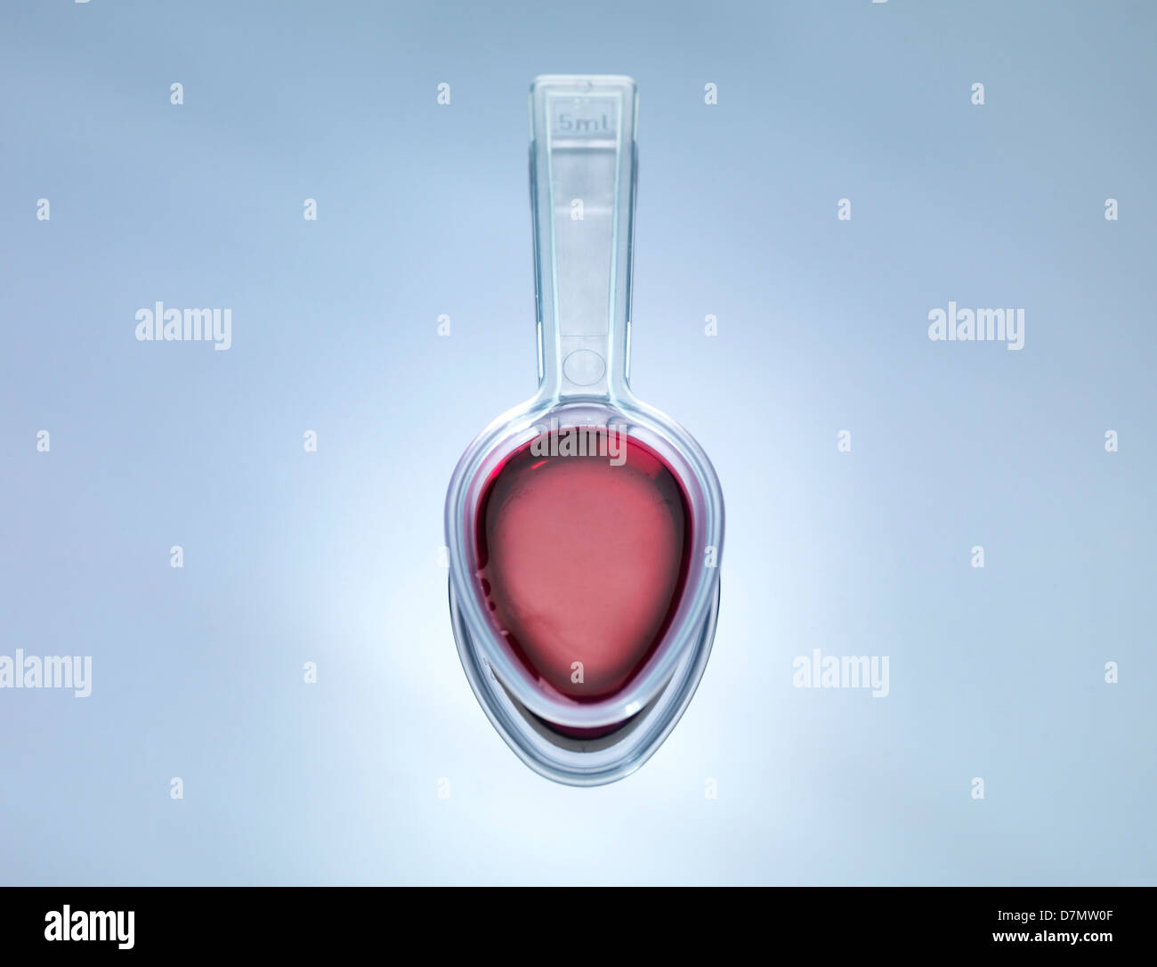 Spoonful of medicine - Stock Image