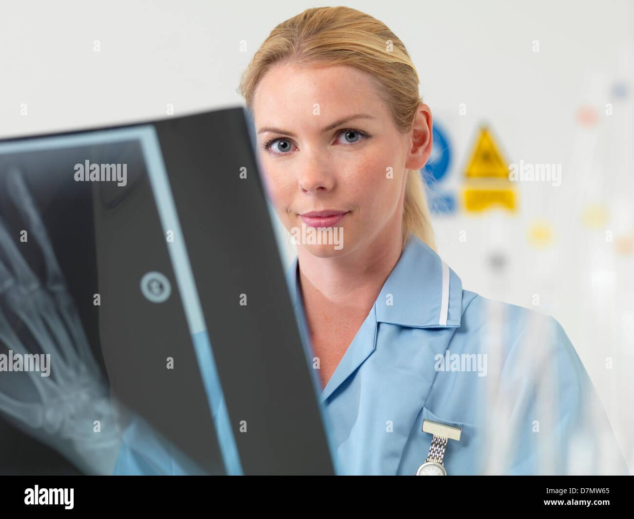 Radiologist examining an X-ray - Stock Image