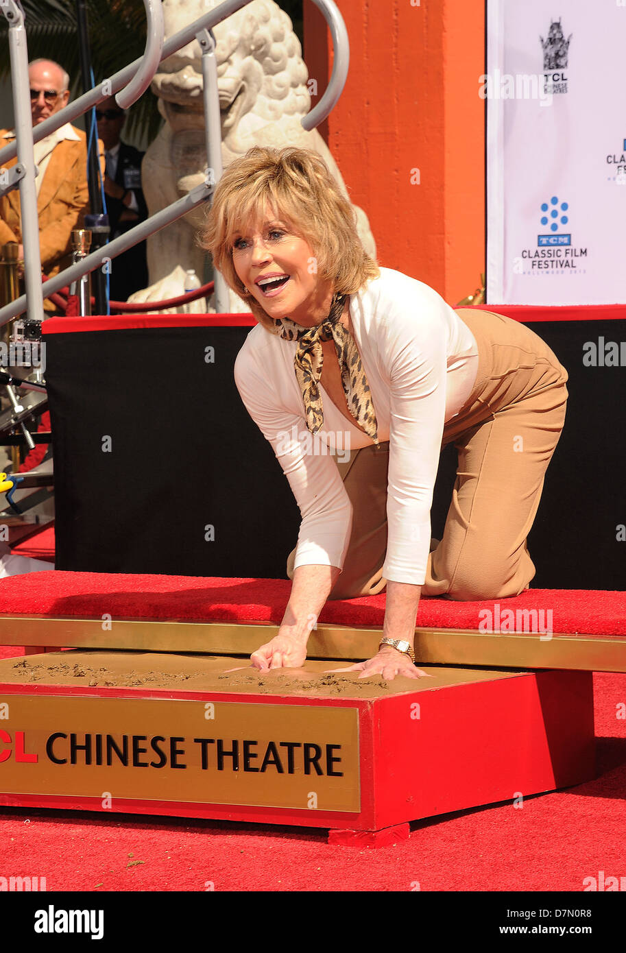 JANE FONDA  US film actress makes her hand impressions at Grauman's Chinese Theatre in LA in May 2013. Photo - Stock Image