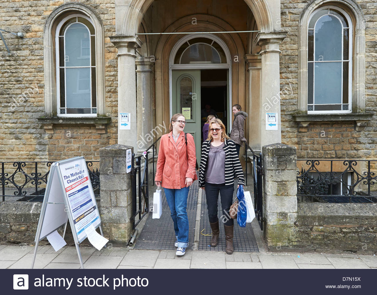 Audience leaving The Methodist Church Hall at the Chipping Norton Literary Festival 2013. CREDIT Geraint Lewis - Stock Image