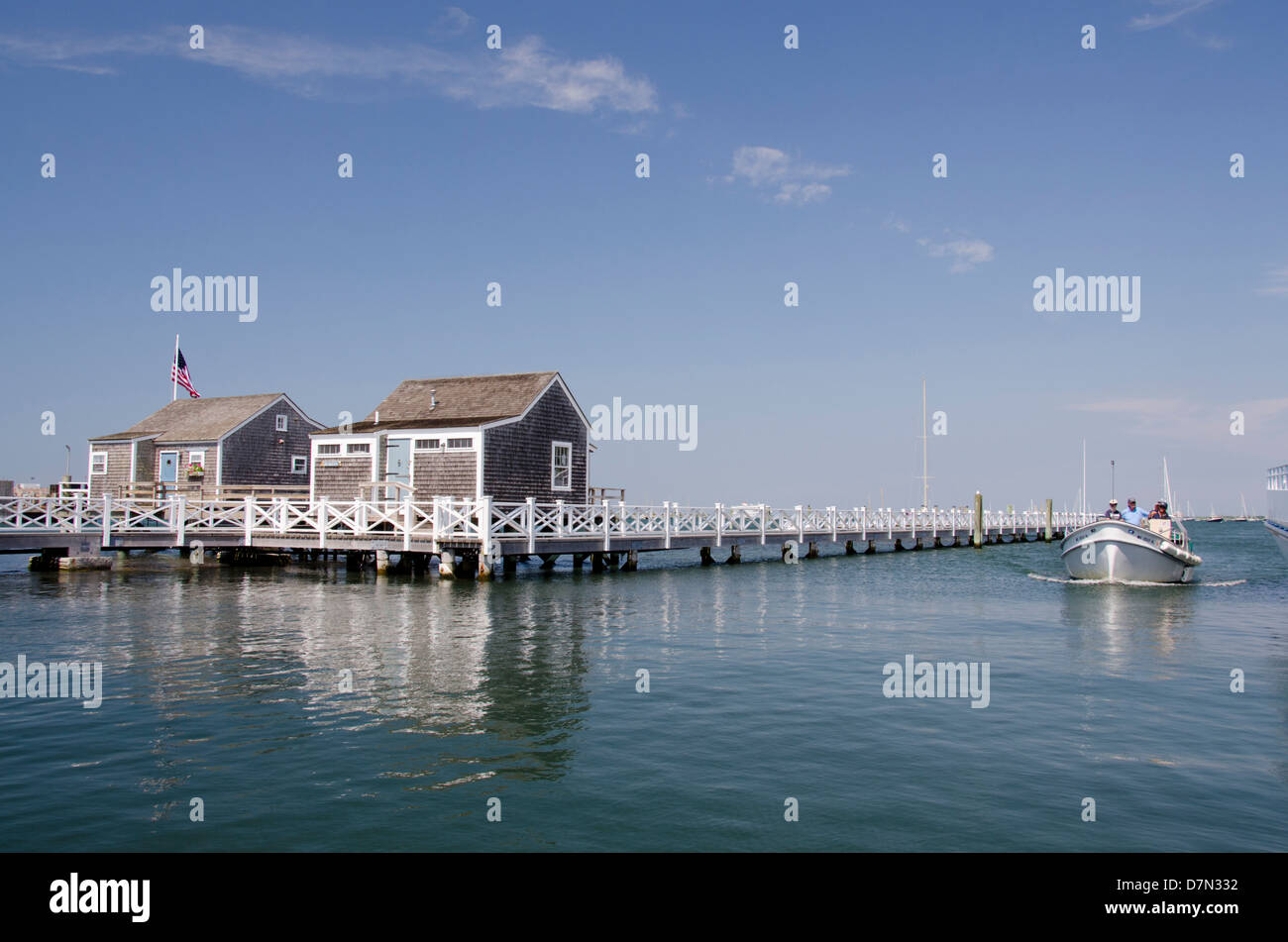 Massachusetts, New England, Nantucket. Straight Wharf water taxi and typical waterfront cottages. - Stock Image