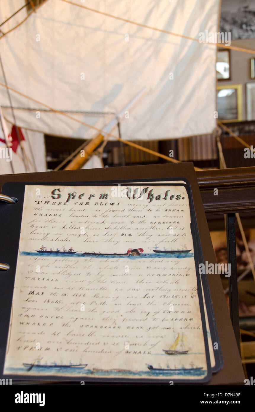 Massachusetts, New Bedford. New Bedford Whaling Museum, whaling log book in front of half-scale model of whaling - Stock Image
