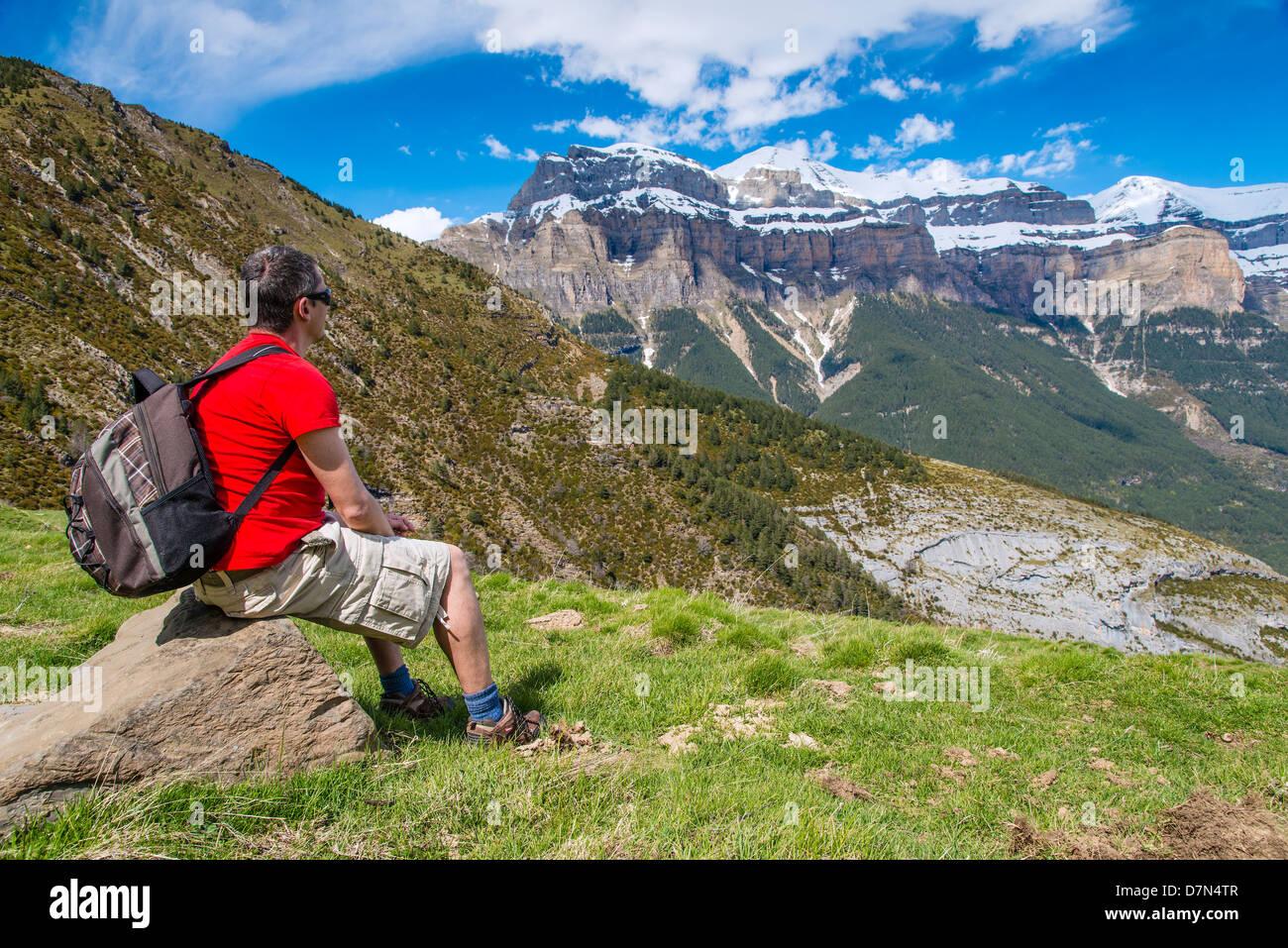 Caucasian male hiker watching the panorama in Ordesa and Mount Perdido National Park, Huesca, Aragon, Spain - Stock Image