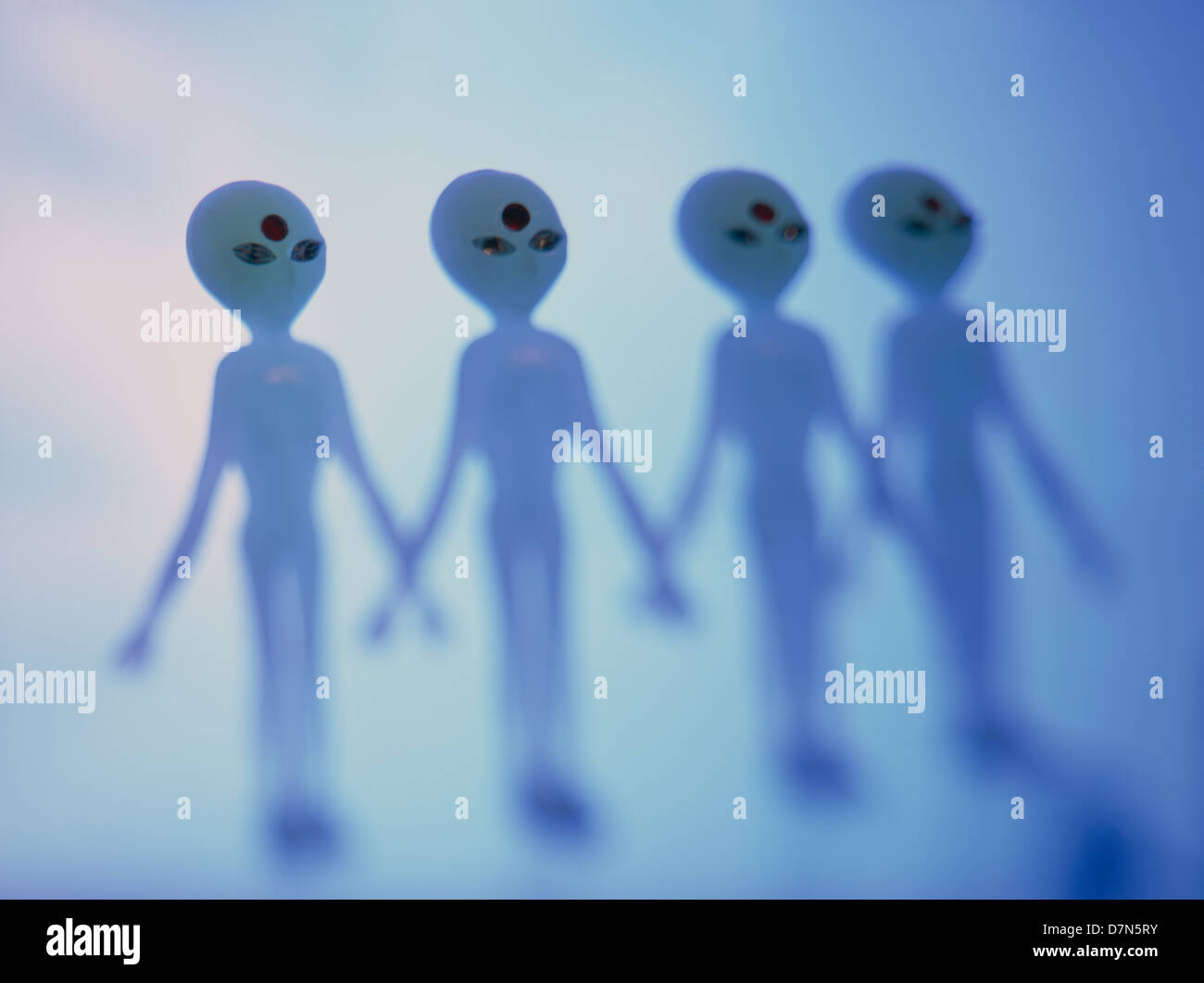 Four blue aliens in a row, ©mak. - Stock Image