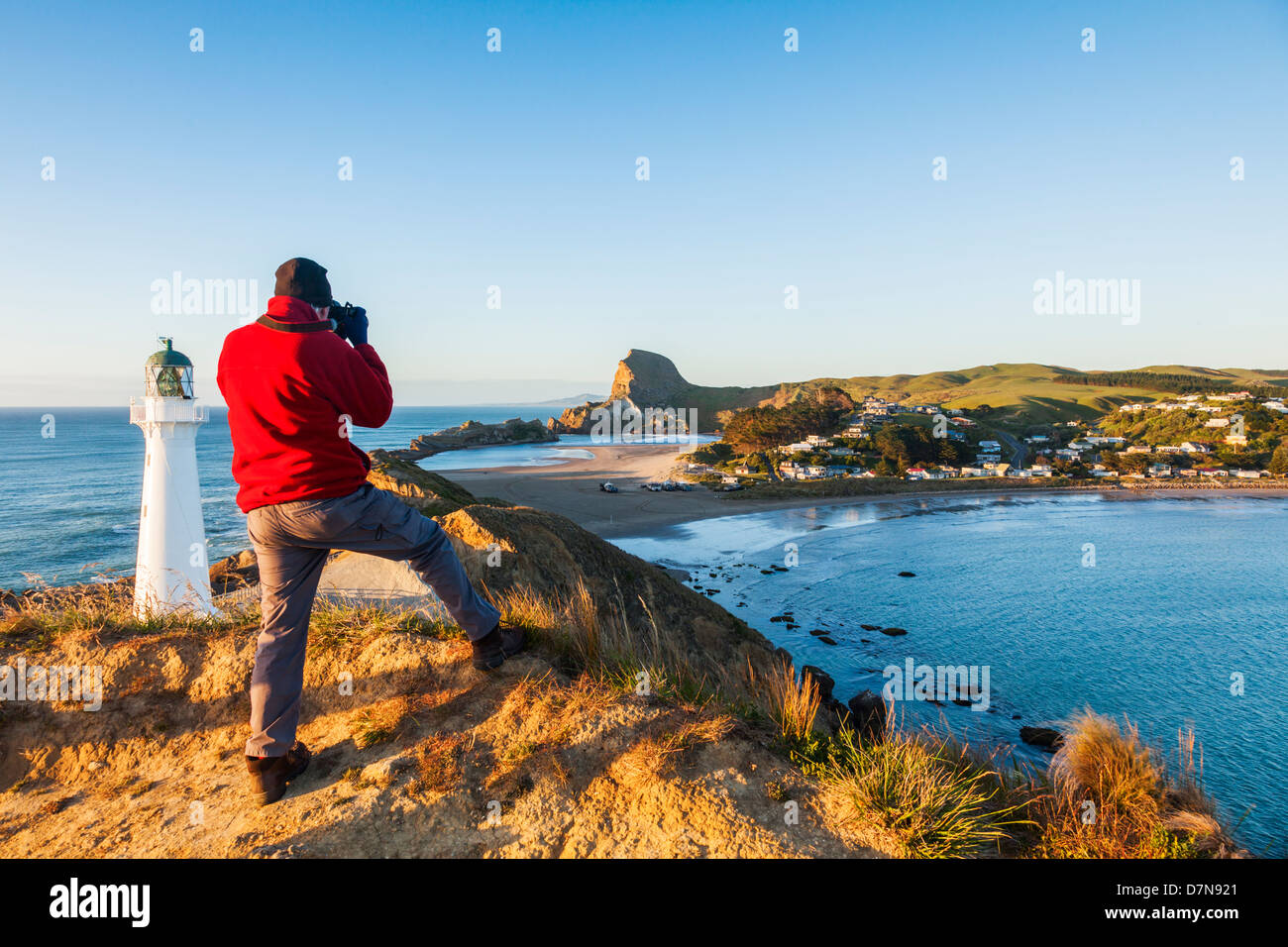 Photographer at Castlepoint Lighthouse, Wairarapa, New Zealand. - Stock Image