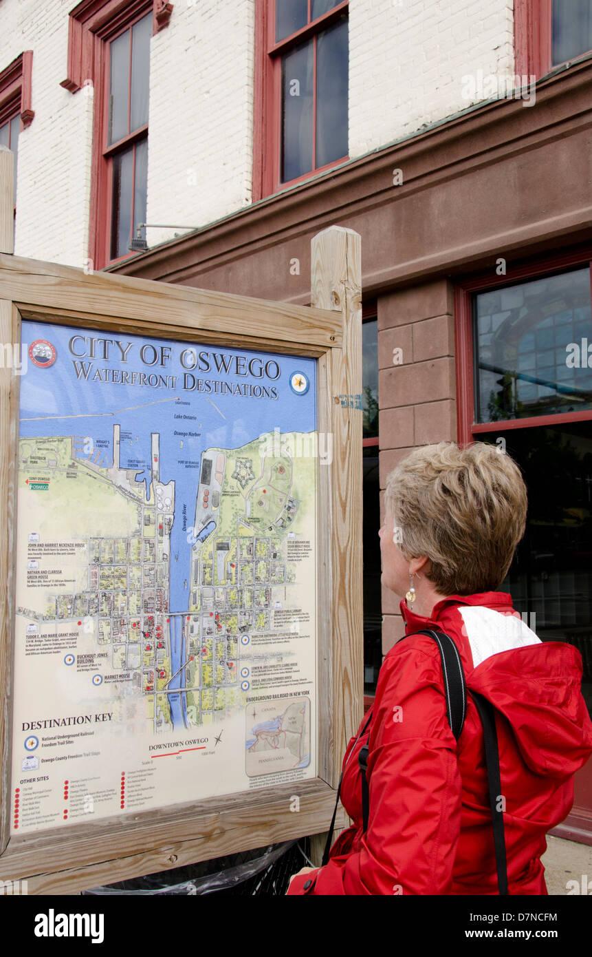Map Of New York Oswego.New York Oswego Tourist Looking At Oswego City Map In Downtown