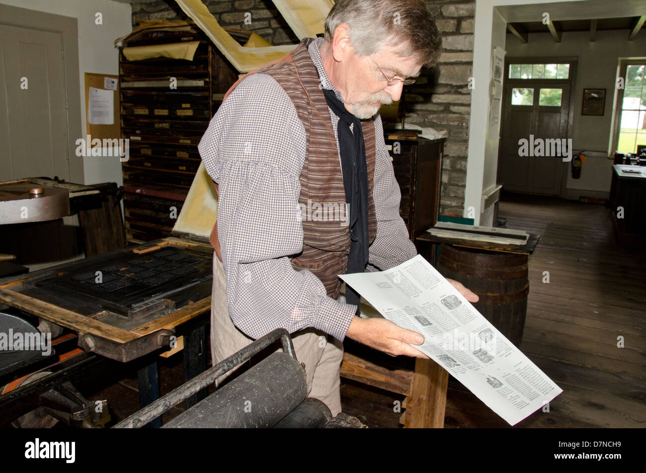 New York, Cooperstown, Farmers' Museum. Costumed worker' printing demonstration. Educational, tourism, or - Stock Image