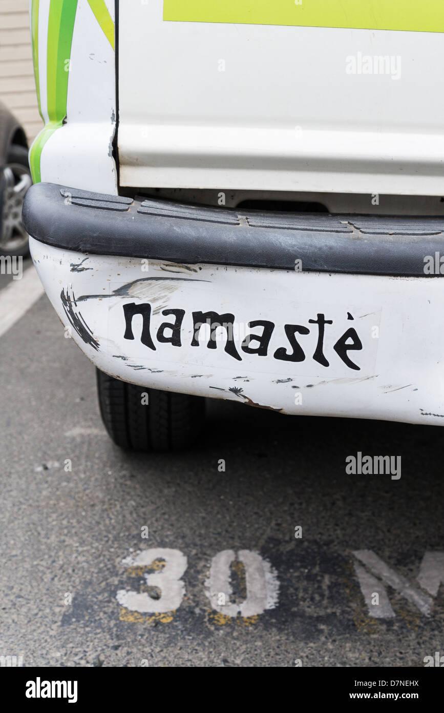 Namaste painted over car bumper damage - Stock Image