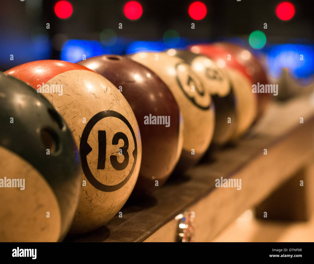 Retro style bowling balls racked and ready to play at the Goodnight bowling Alley in Austin, Texas - Stock Image
