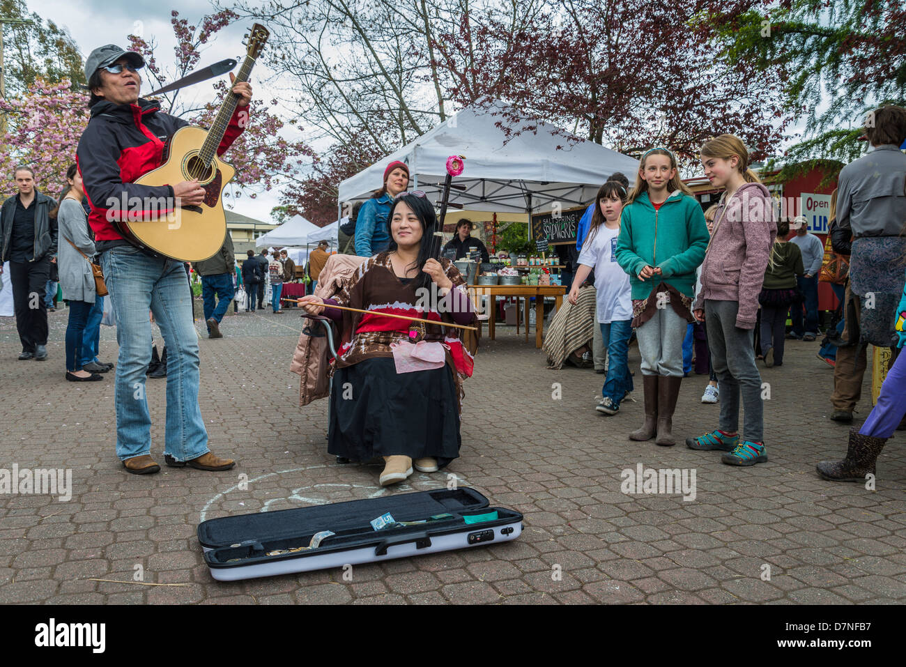 Buskers at the Saturday Market, Salt Spring Island, British Columbia, Canada - Stock Image