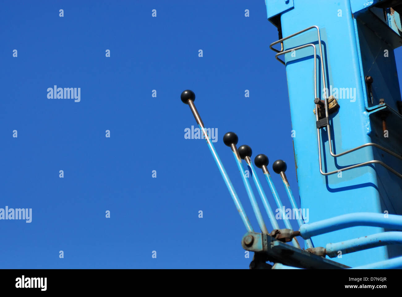 Control levers against clear blue sky. - Stock Image