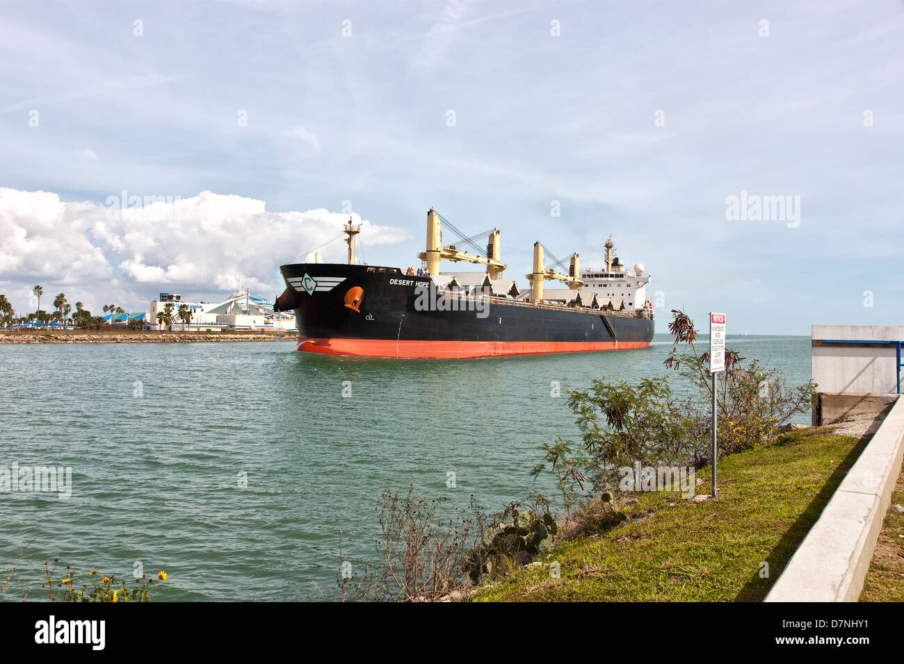 Freighter transporting grain, entering Port Of Corpus Christi. Stock Photo