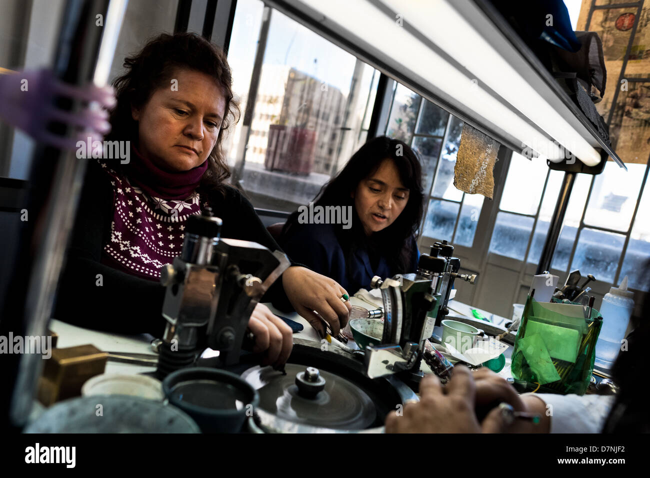 Emerald cutters work in a cutting and polishing workshop in Bogota, Colombia. - Stock Image