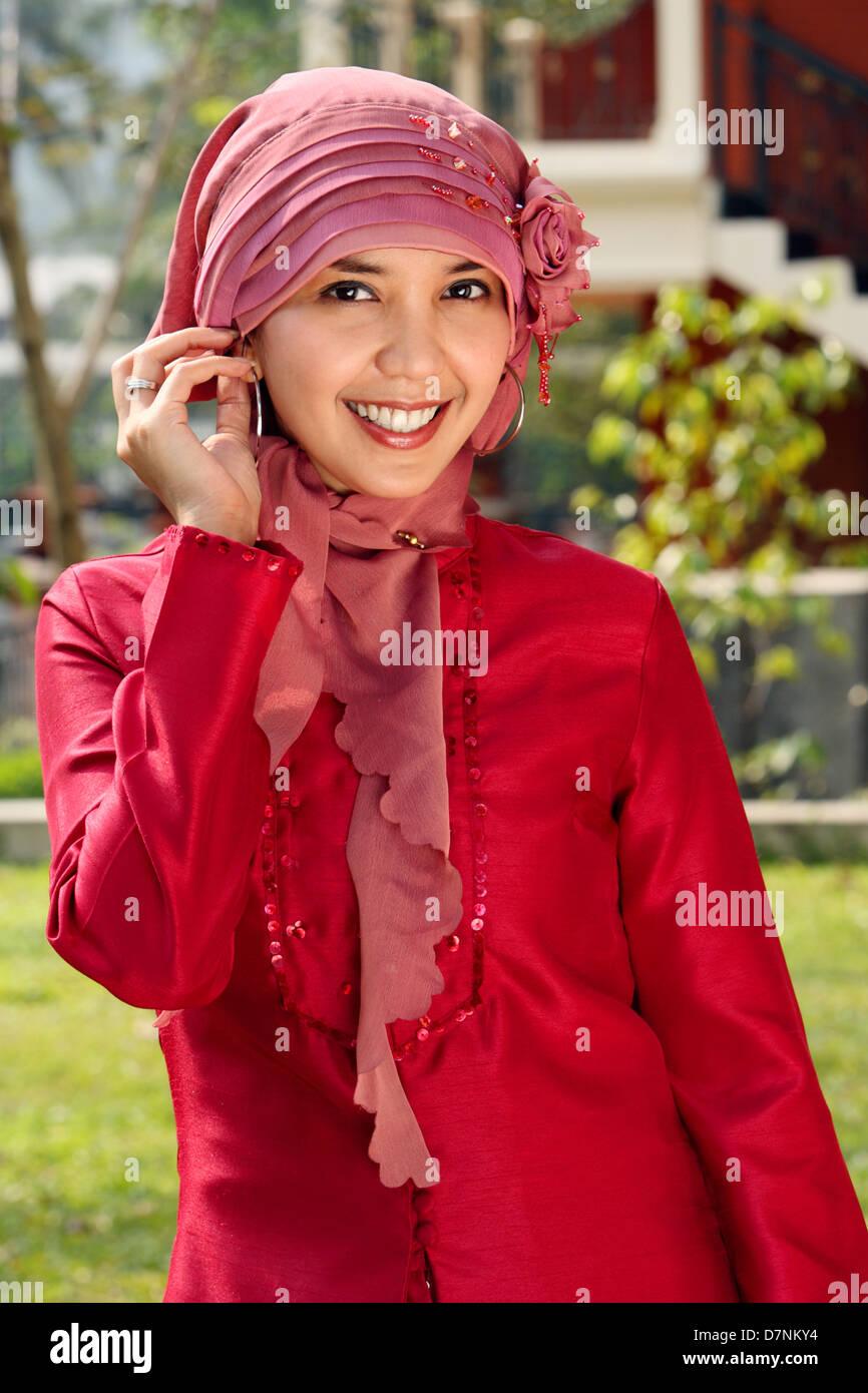 Outdoor portrait of happy Muslim woman - Stock Image