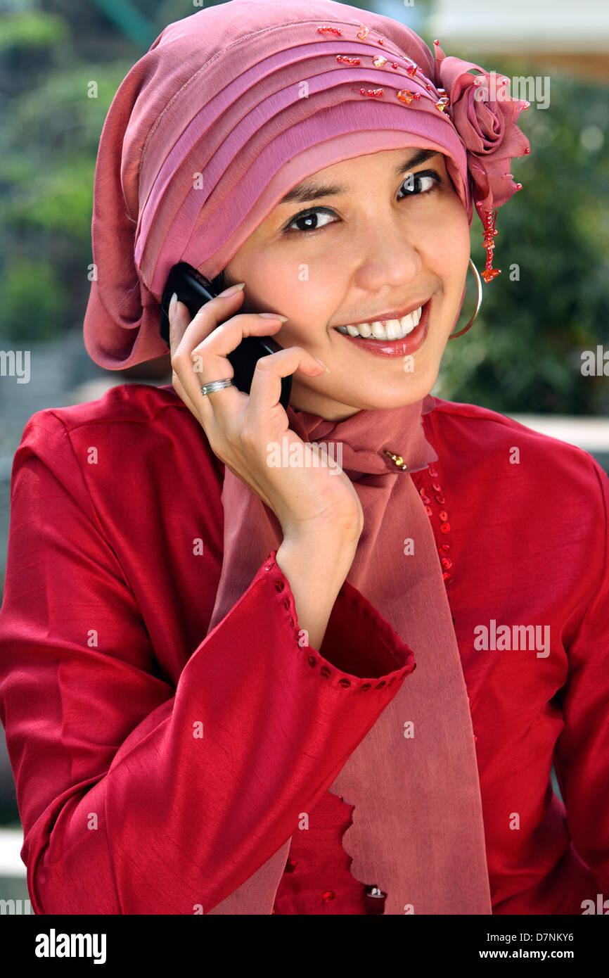Muslim business woman talking on the phone - Stock Image