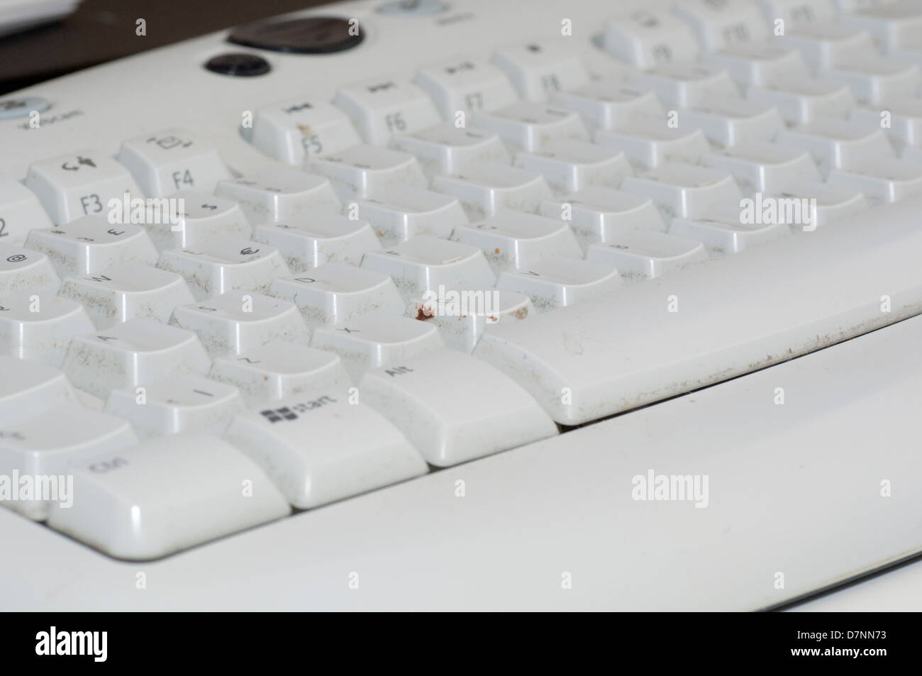 Close-up of a filthy, real-life computer keyboard - Stock Image