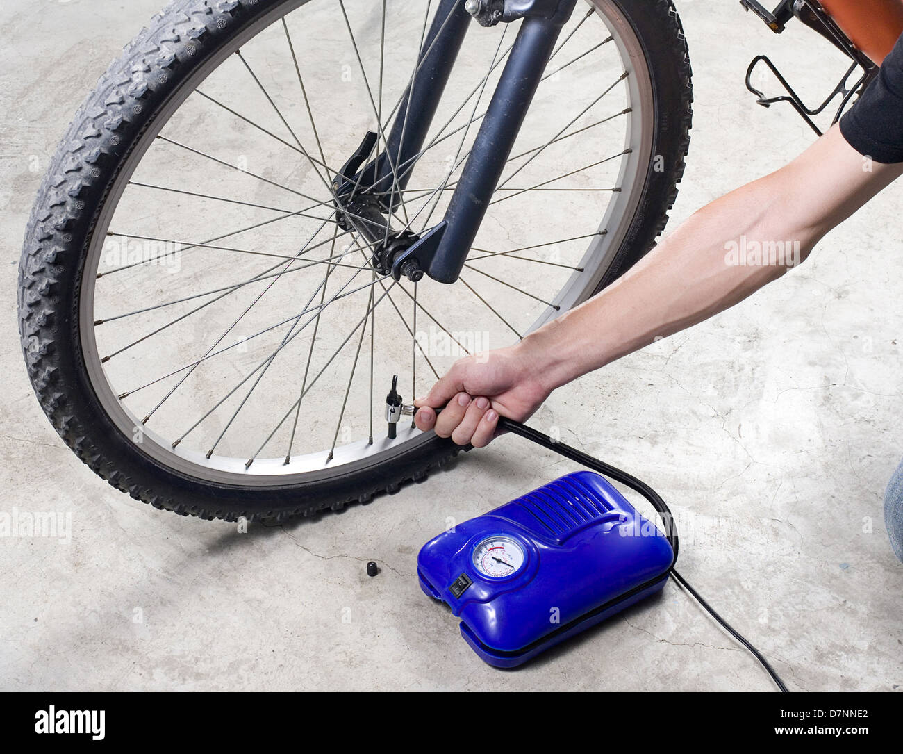Inflate The Bicycle Tire With Compact Air Compressor Stock Photo