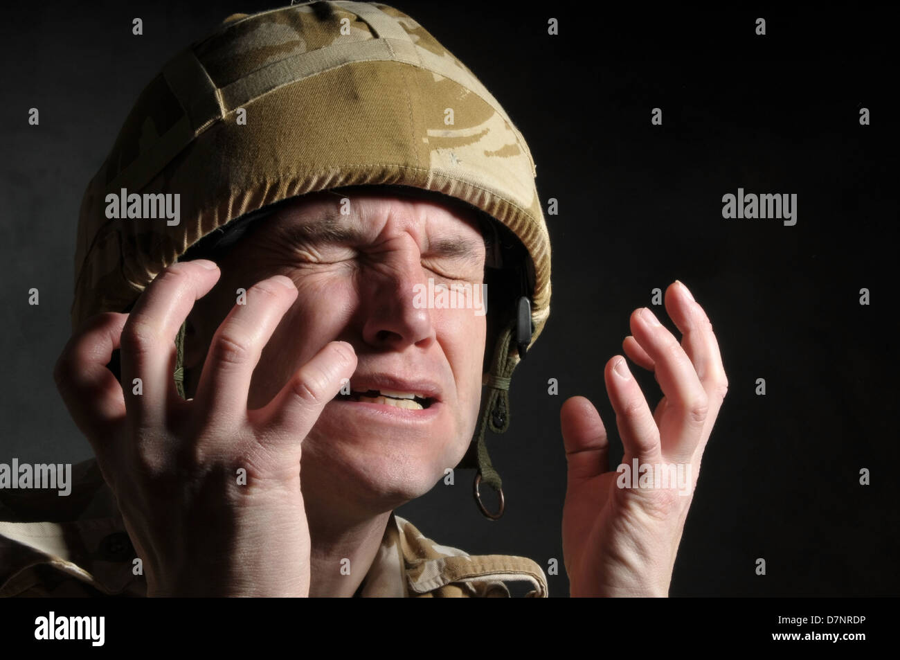 British soldier suffering from shell shock/PTSD, against a black background. - Stock Image