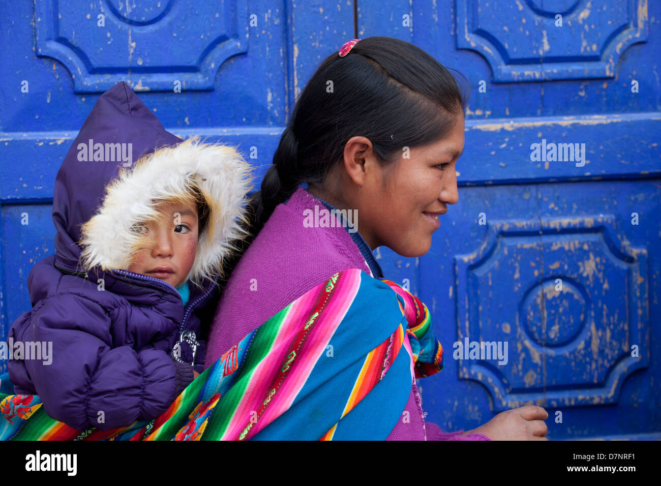 Quechua woman with baby - Stock Image
