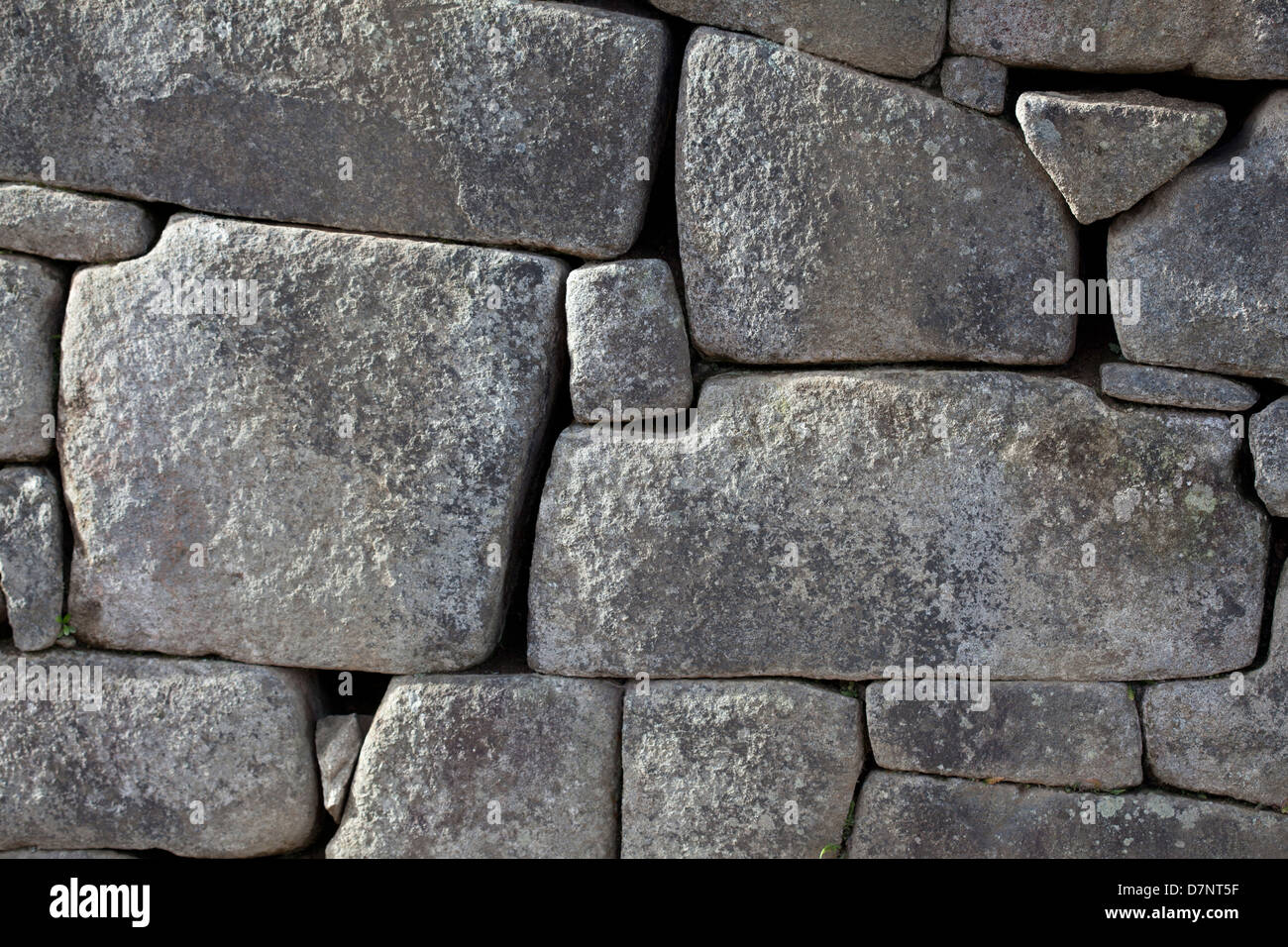 Stone Masonry Precision  at the Archaeological site of the Inca city of Machu Picchu - Stock Image