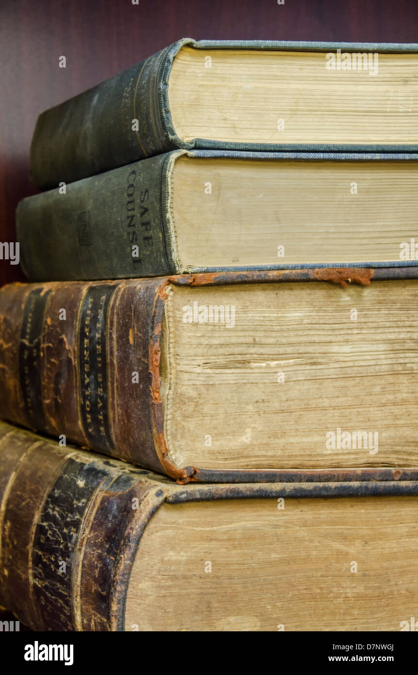 A stack of old worn-out books - Stock Image