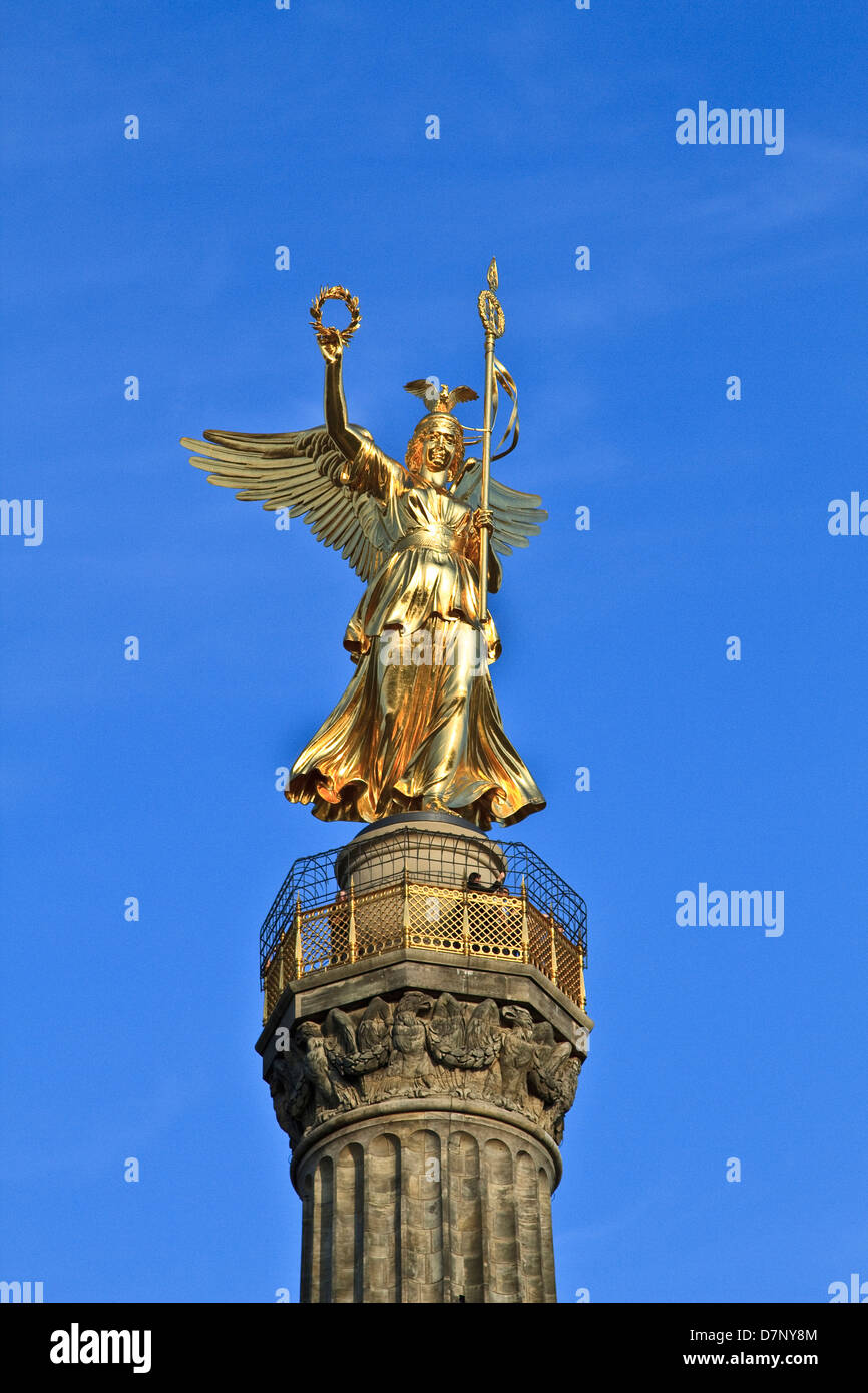 Golden statue of Victoria on top of the Siegessaule (Victory Column) in Berlin - Stock Image