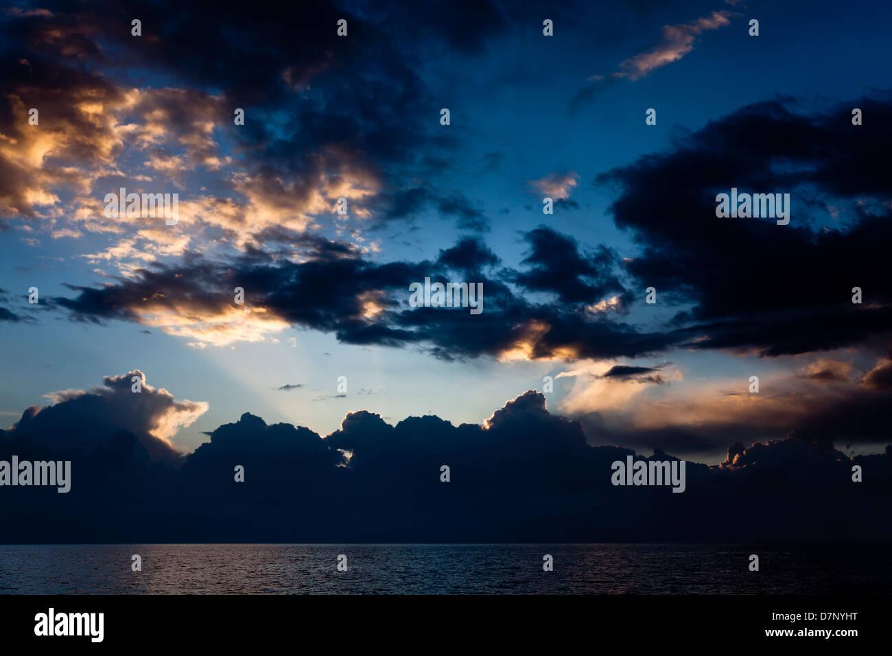 Sunrise over the Greek mainland coast, Ionian Sea off Corfu - Stock Image