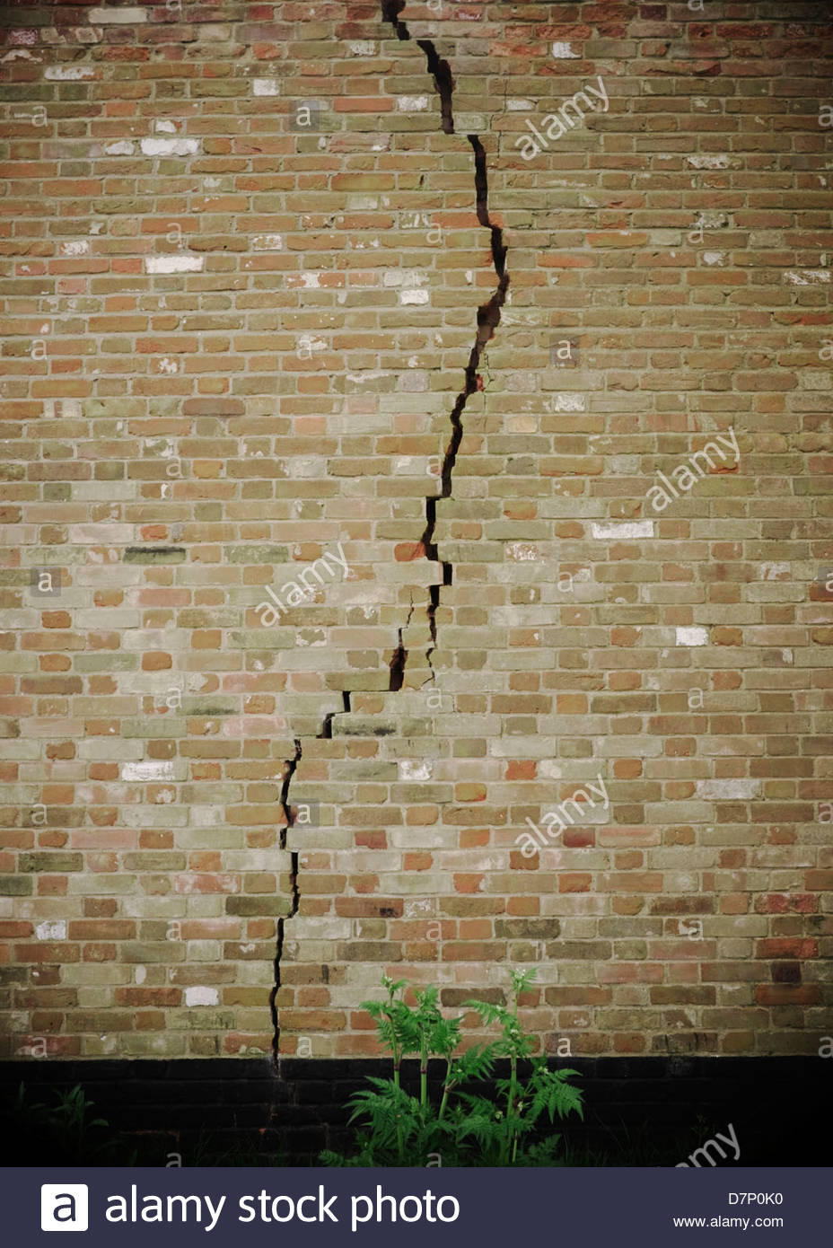 Fracture/crack in a brick wall. Earthquake/fracking concept. - Stock Image