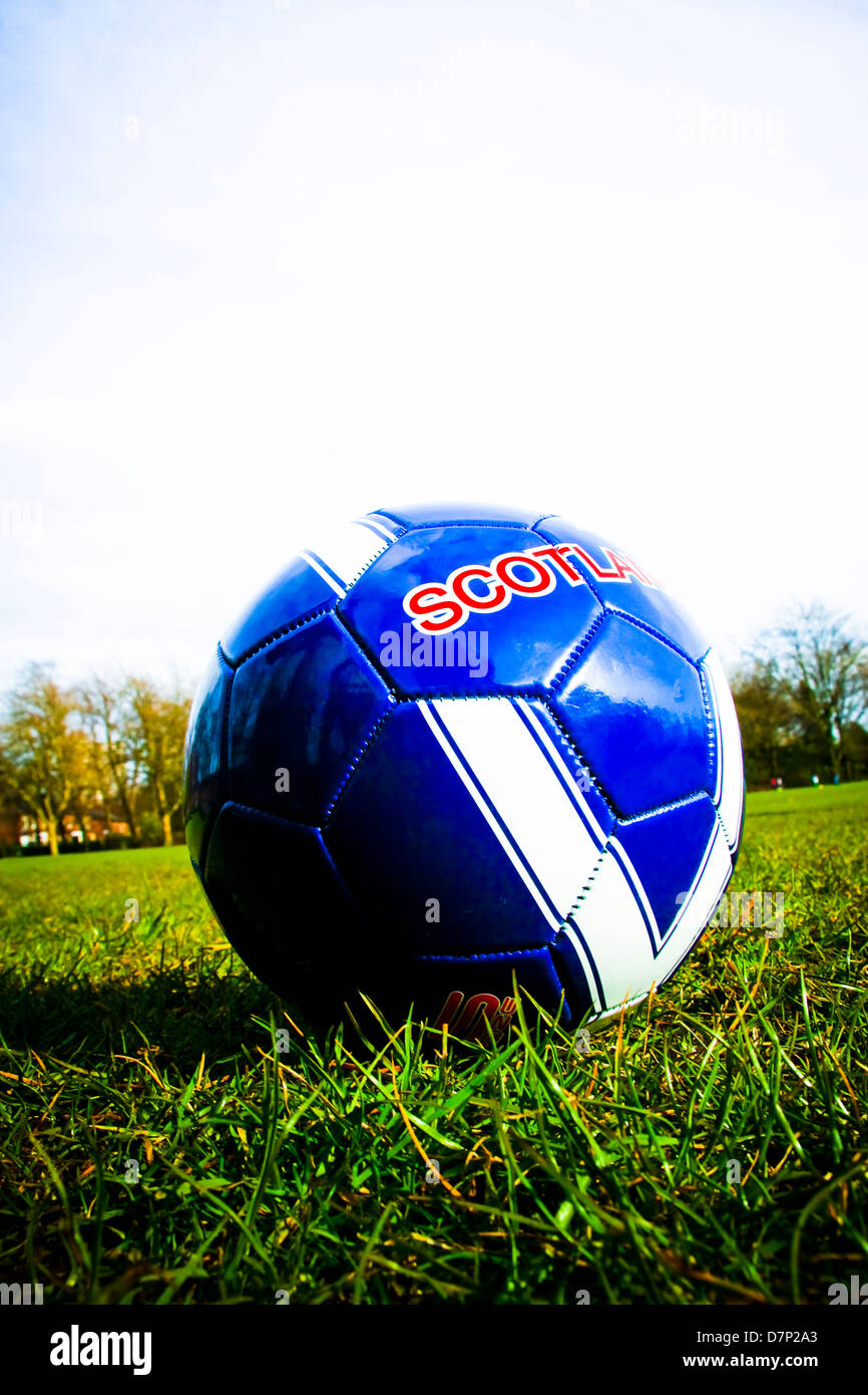 Scotland branded leather football on grass - Stock Image
