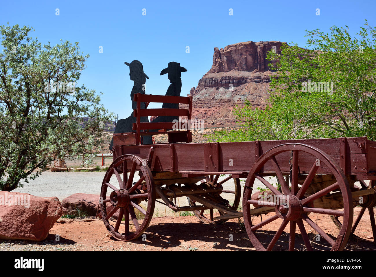 A wooden wagon with cutouts of old west pioneers. Moab, Utah, USA. - Stock Image