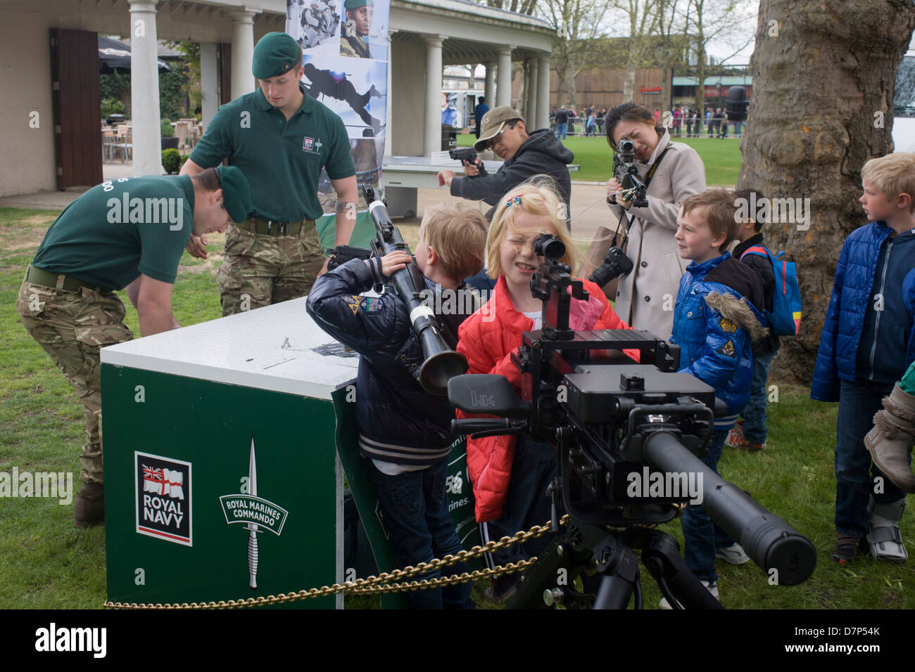 Members of Royal Marines Commandos demonstrate various weaponry to small children and young adults during a public - Stock Image