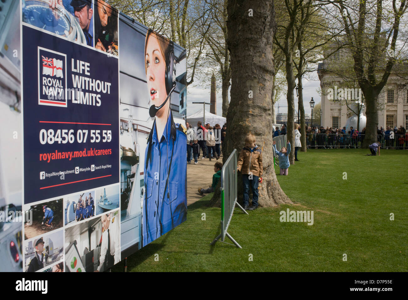 A families queue, a Royal Navy careers recruitment trailer is parked in the grounds of the Naval College in Greenwich, - Stock Image