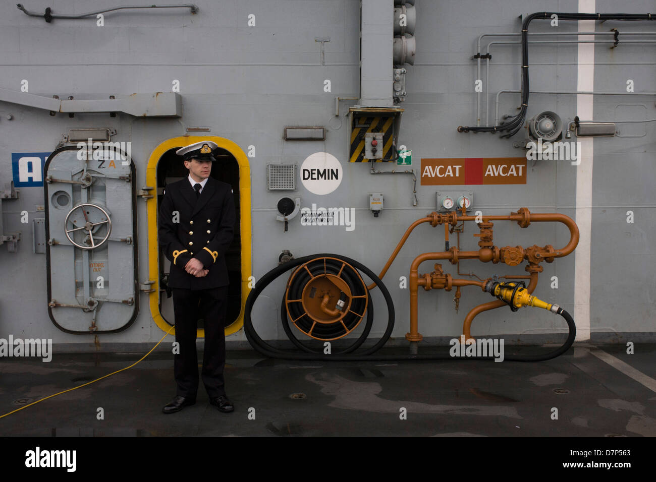 A student officer on duty on the top deck during a tour by the general public on-board the Royal Navy's aircraft - Stock Image