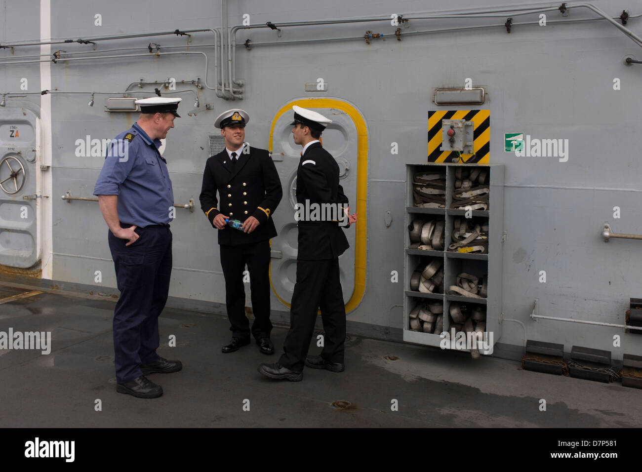 Student officers and a rating on duty on the top deck during a tour by the general public on-board the Royal Navy's - Stock Image