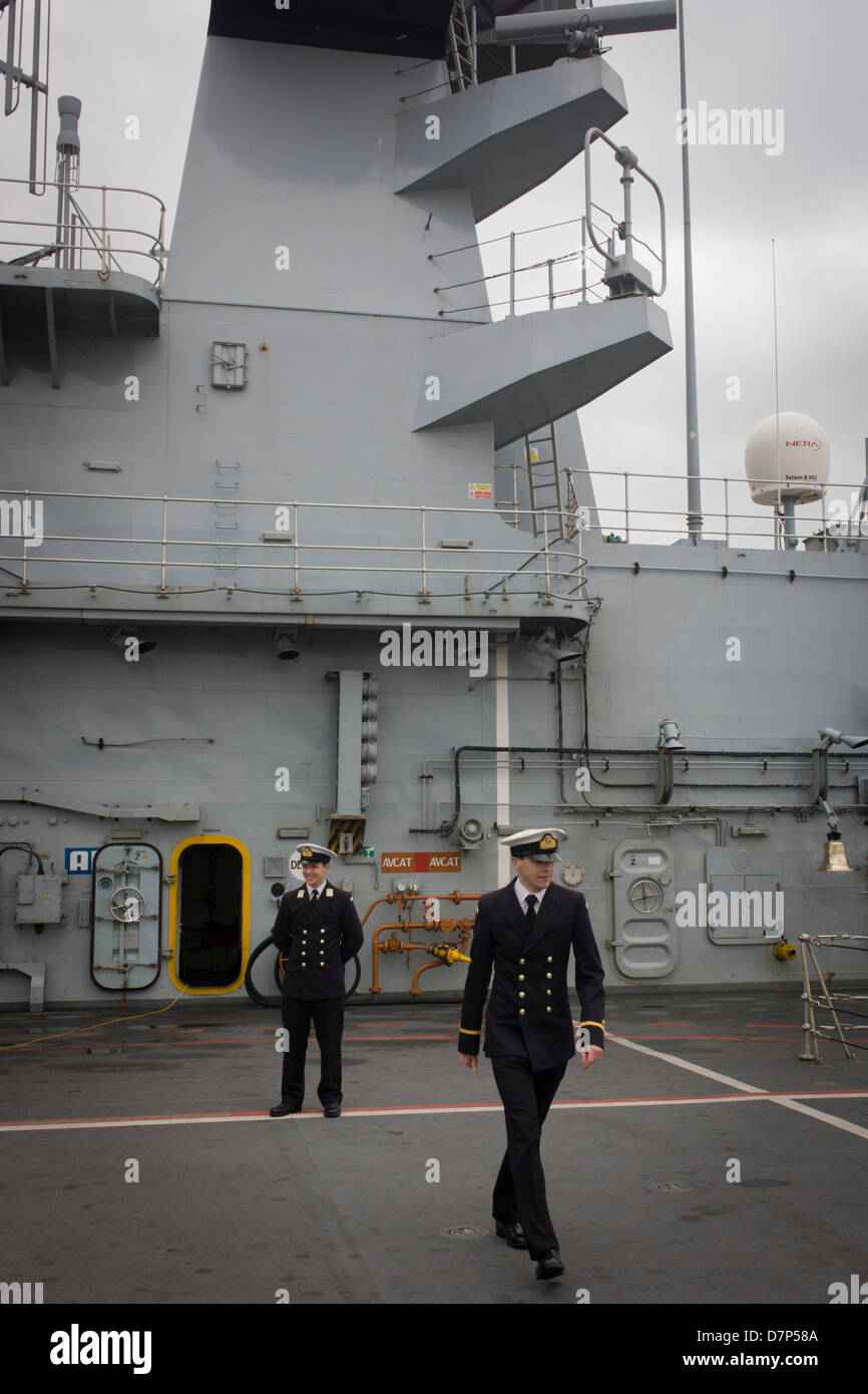 Two student officers on duty on the top deck during a tour by the general public on-board the Royal Navy's aircraft - Stock Image