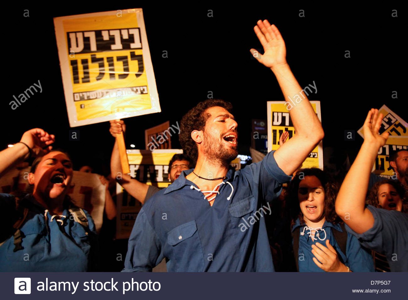 Members of the youth wing of Israeli Labor Party holding placards which reads 'Bibi is bad for us' and shouting - Stock Image