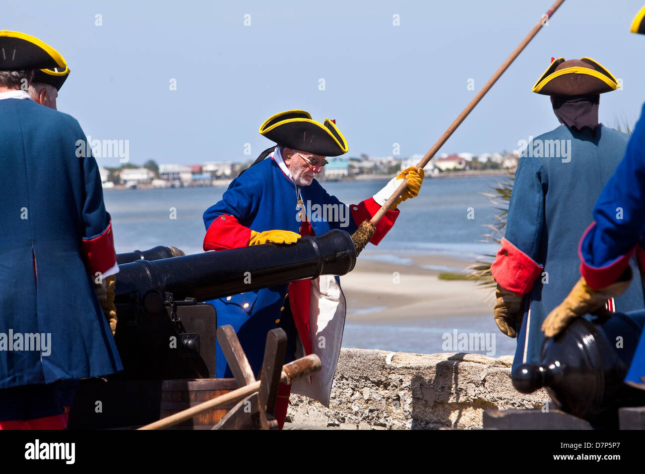 Reenactors operate a canon at the Castillo de San Marcos Fort in St. Augustine, Florida - Stock Image
