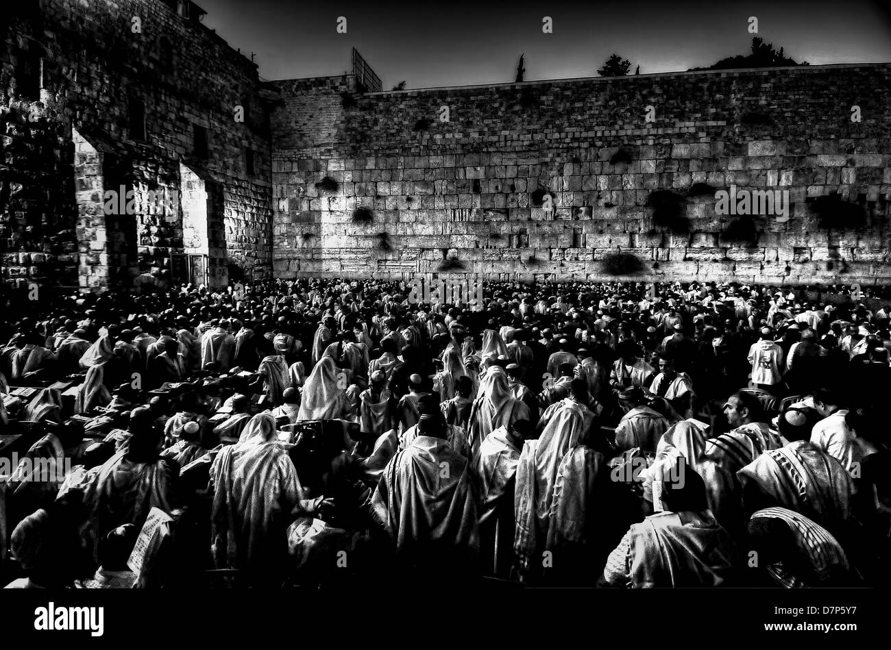 Prayers in the Western Wall at Dusk, Yom Kipur mass Prays, The old city of Jerusalem. Black and white photo. - Stock Image
