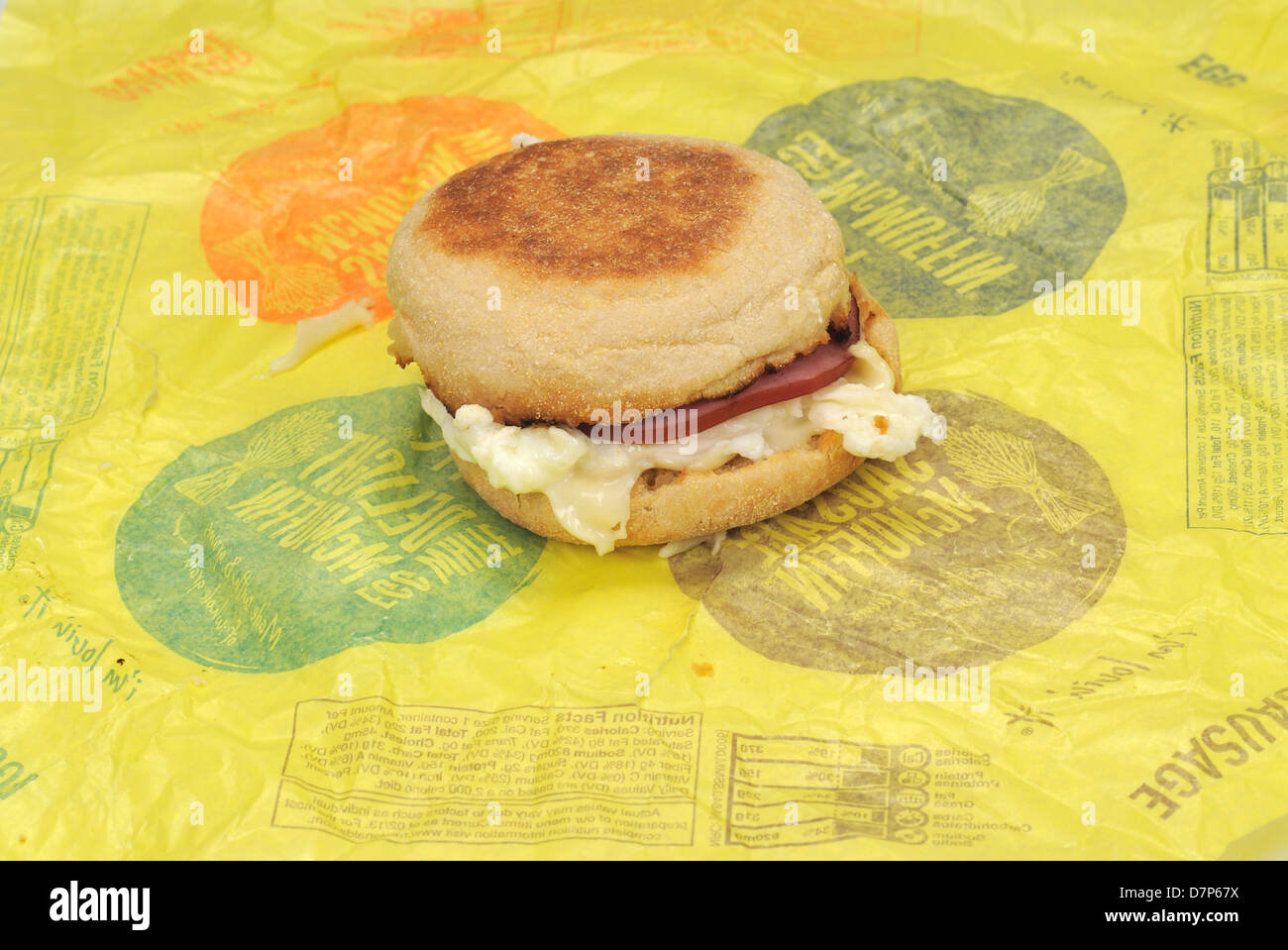 McDonald's Egg White Delight McMuffin breakfast sandwich on paper wrapper. USA - Stock Image