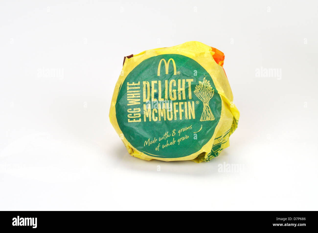 McDonald's egg white delight mcmuffin with canadian bacon in wrapper on white background, cutout. USA - Stock Image