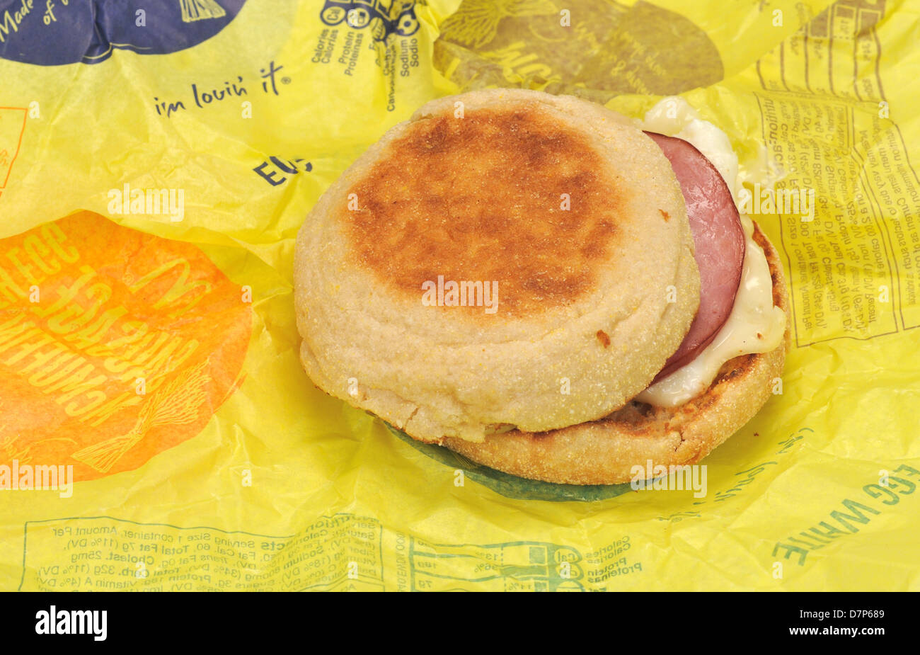 McDonald's Egg White Delight McMuffin breakfast sandwich with canadian bacon on paper wrapper. USA - Stock Image
