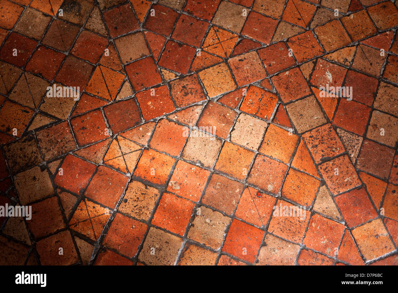 Antique terracotta floor tiles. - Stock Image