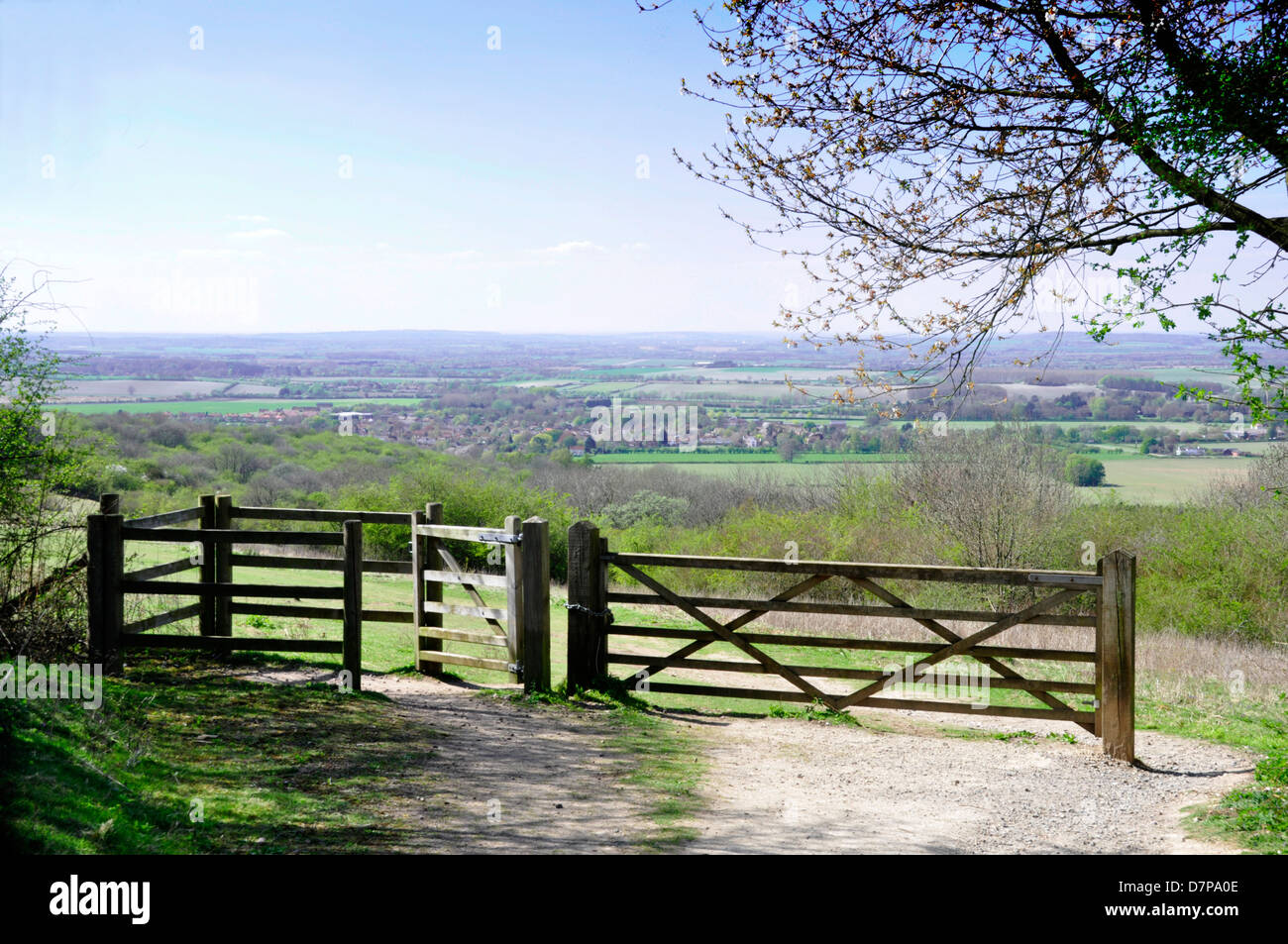 Oxon - Chiltern Hills - footpath and gateway on to Watlington Hill - distant view over countryside to Watlington - Stock Image