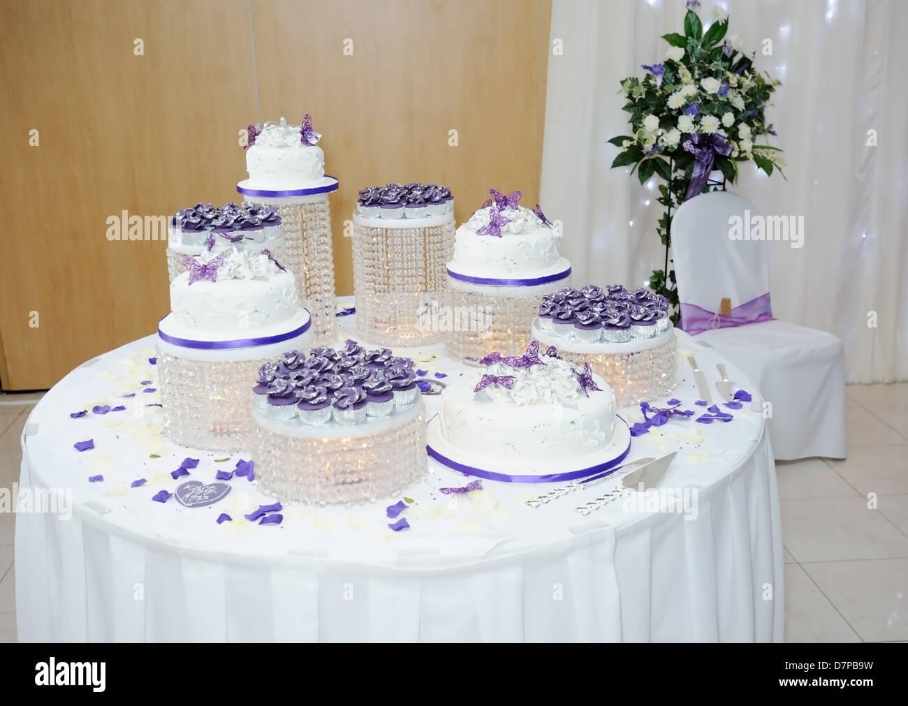 Big white and purple asian wedding cake at reception Stock Photo ...