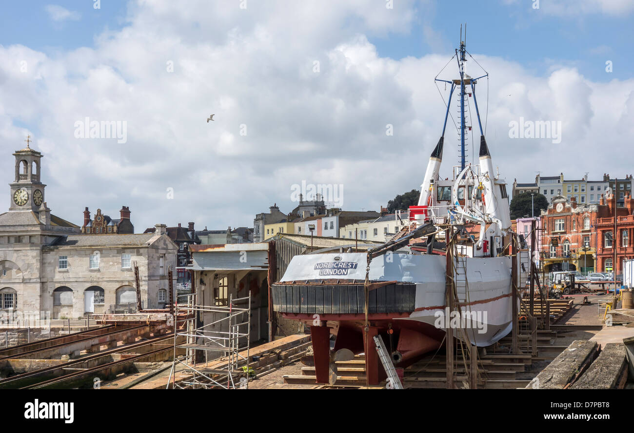 The Nore Crest Tug on the Slipway at Ramsgate Harbour Seafront. - Stock Image