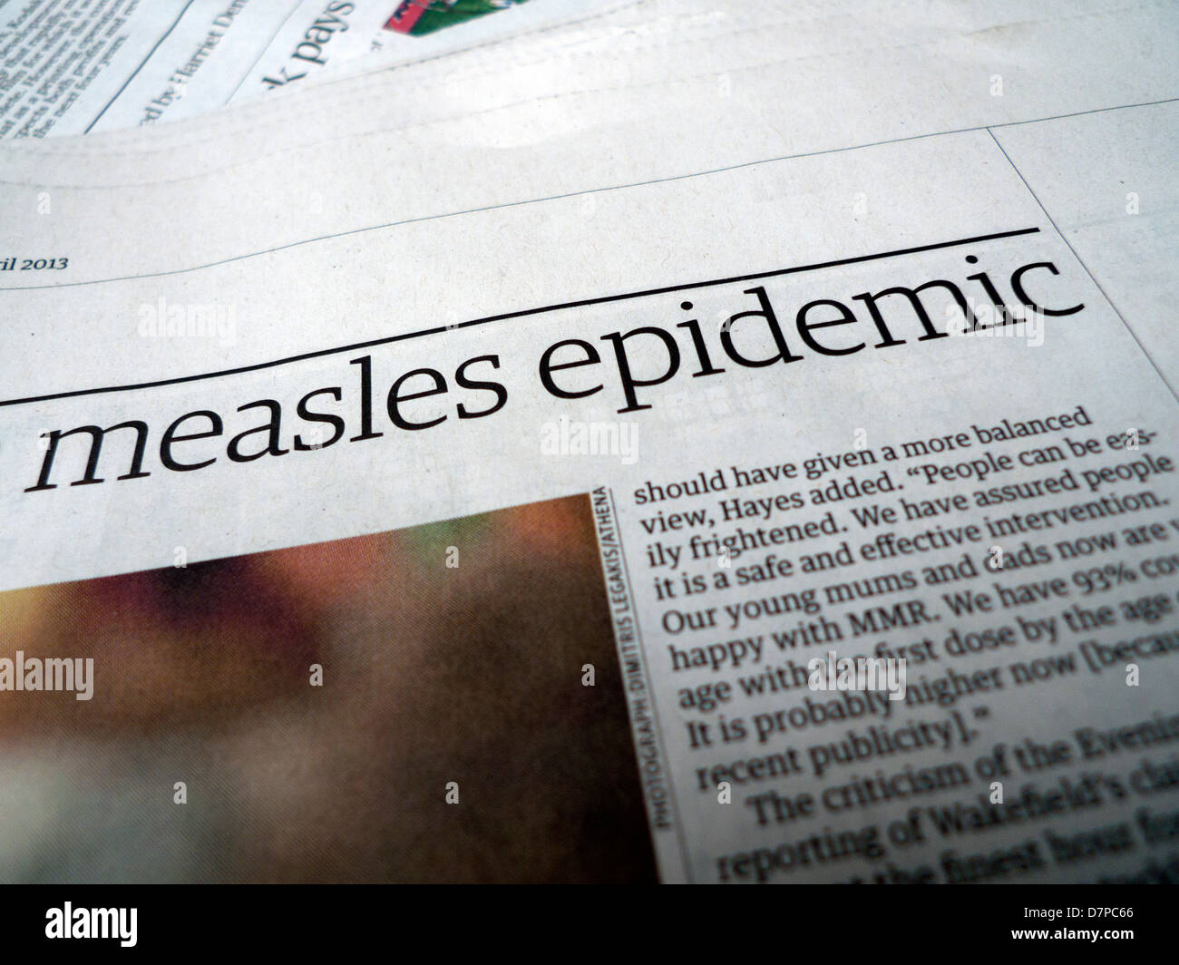 An article about the measles epidemic in Britain in the Guardian newspaper UK Spring 2013 - Stock Image